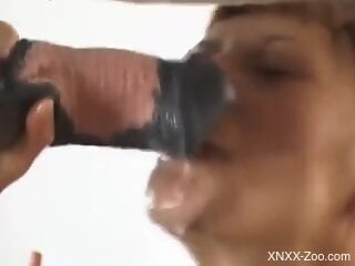 Slutty babe puts a cumming horse cock on her lips